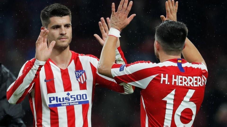 Atletico Madrid's Alvaro Morata and Hector Herrera celebrate after the match