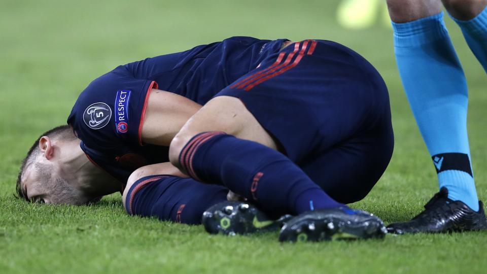 Bayern's Lucas Hernandez lies on the ground.