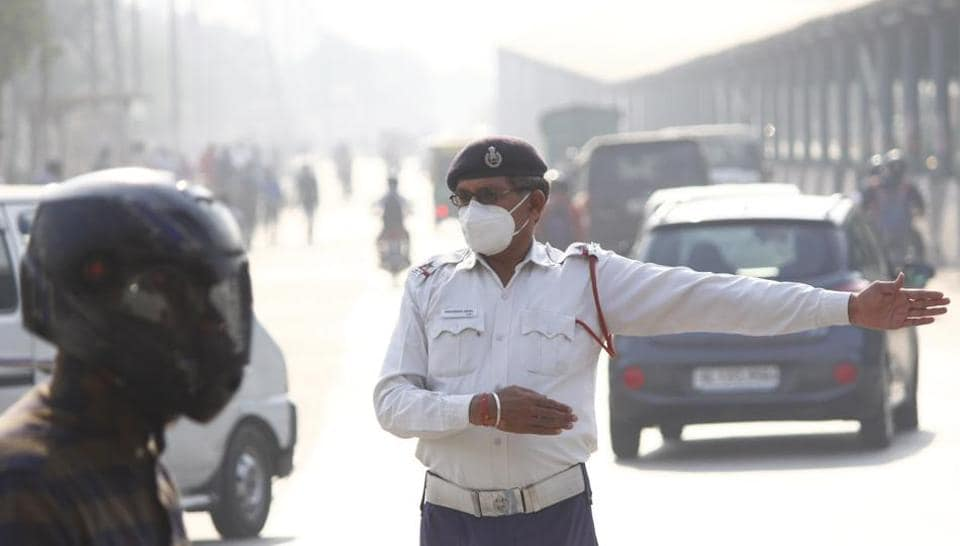 A traffic police personnel wearing anti-air pollution mask, at Hero Honda Chowk, in Gurugram,  on Wednesday, October 23, 2019.