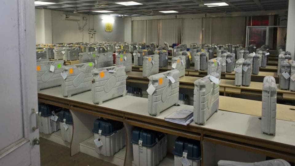 Cases containing electronic voting machines sit in a strong room before the beginning of vote counting.