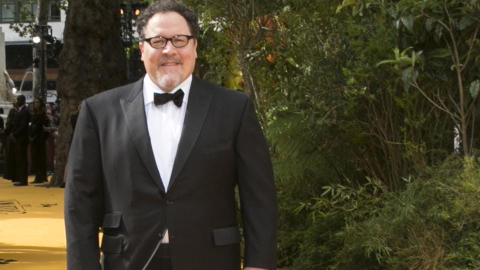 Director Jon Favreau poses for photographers upon arrival at the Lion King European premiere in central London.