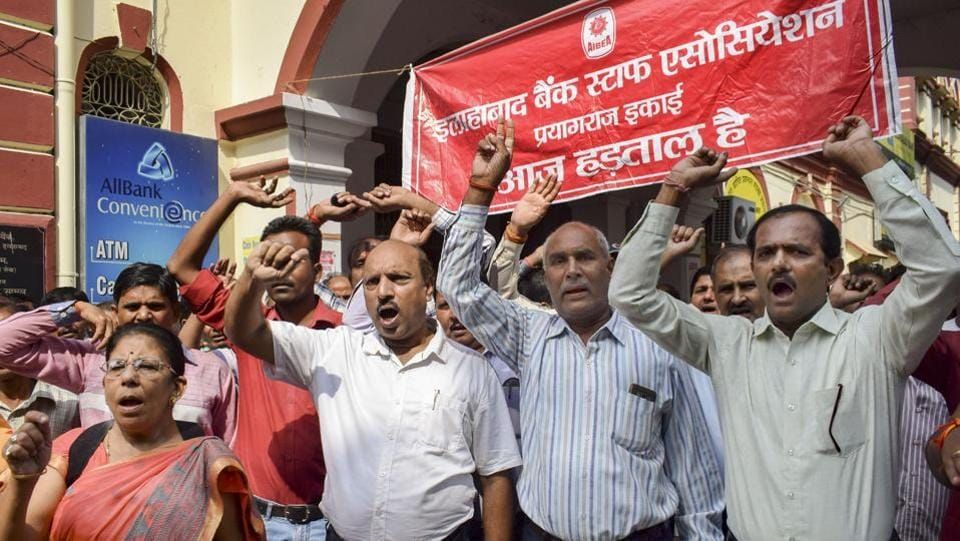 Bank employees shout slogans during the strike in Prayagraj, Uttar Pradesh. The state-owned banks account for nearly two-thirds of banking assets in the country and also have a lion's share in the nearly $150 billion of soured loans in the banking sector. (PTI)