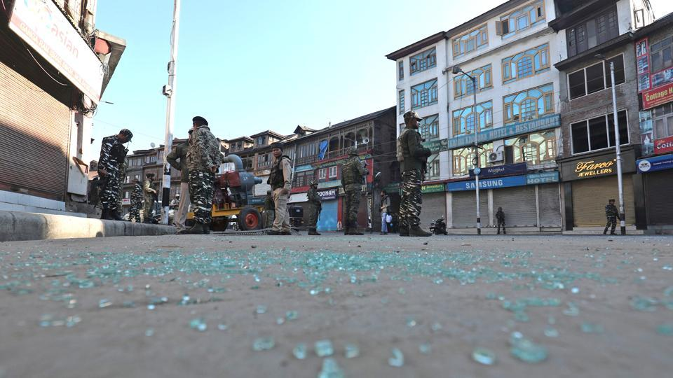 Paramilitary soldiers stand guard at the site of the grenade attack, at Hari Singh High Street, in Srinagar, Jammu and Kashmir on October 12.