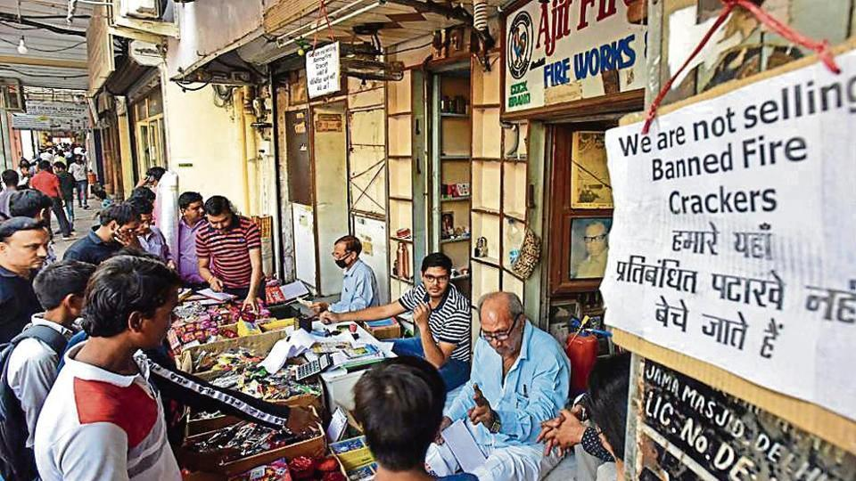 A signage board hangs at a store selling green crackers ahead of Diwali celebrations, in Chandni Chowk, New Delhi on Wednesday.