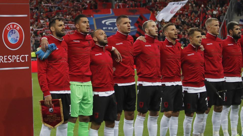 File image of Referees and Albania's soccer team stand during Albania's national anthem