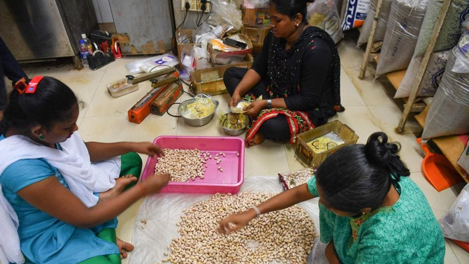 "Staff sort pistachios to pack into gift boxes with sweets at a factory in Mumbai. Even orders for the cheapest items -- small boxes of Indian almonds, walnuts, and cashews -- have fallen by more than half, Shah said, bringing down the firm's annual turnover by 35% and leaving him with no funds for employee bonuses, another Diwali tradition. ""Diwali is not only the festival of lights but also represents economic prosperity,"" Shah said. (Indranil Mukherjee / AFP)"