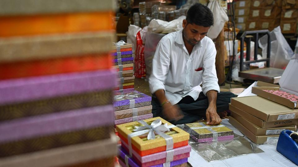 "A staff member packs gift boxes of sweets at a factory. ""Reduction in corporate gifting is an indicator of economic slowdown and there is no ambiguity on that front,"" N. Chandramouli, chief of Mumbai-based TRA Research, told AFP. ""All indicators show it is going to be a slow Diwali this year."" (Indranil Mukherjee / AFP)"