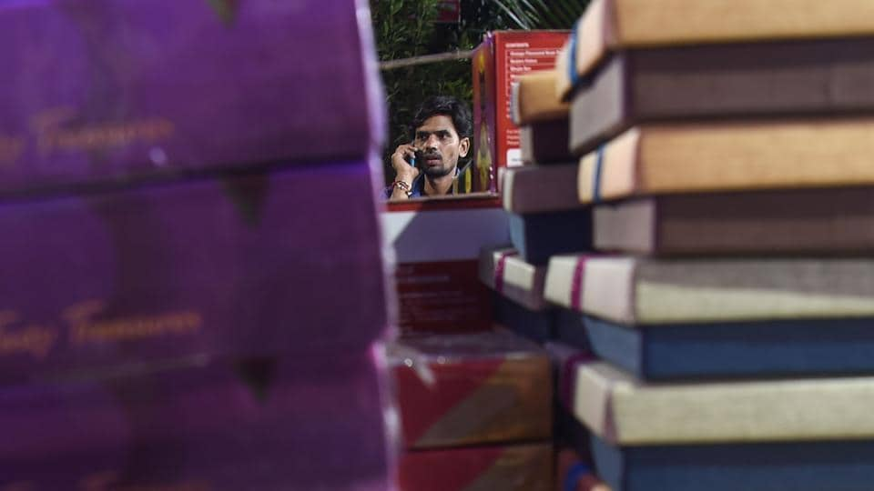 "A staff member takes orders on a phone as he stands next to gift boxes at a store in Mumbai ahead of Diwali. ""Earlier, the quality of gifts we received was higher and often included gold and silver-plated picture frames or bowls. But now, with the economic slowdown, that's all changed,"" Bibhas Chakraborty, a Mumbai-based 48-year-old executive, told AFP. (Indranil Mukherjee / AFP)"