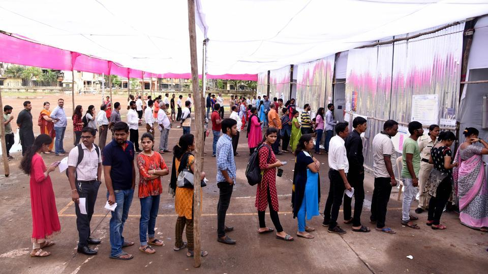 Voters queue up to cast their votes at a school in Ghansoli in Navi Mumbai.