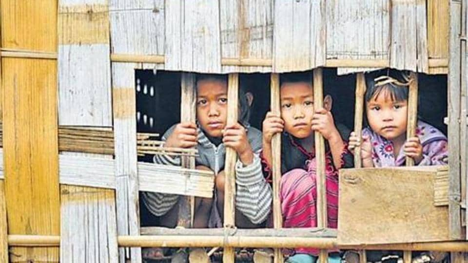 As per the instructions of the MHA, supplies of ration and cash benefits to the Bru camps were stopped since October 1, two days before the repatriation began.  Over 37,000 Bru people had taken shelter in Tripura to escape an ethnic clash in Mizoram in 1997. In this file picture, 3 Bru children seen at a relief camp in Northern part of Tripura.