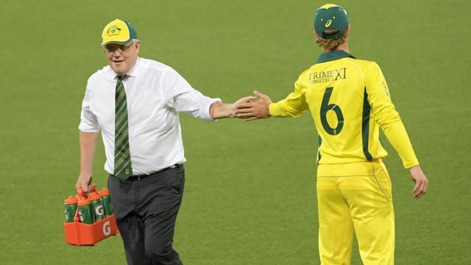 Australia PM Scott Morrison served drinks during a warm-up match