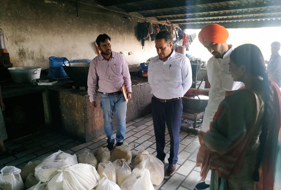 Health officials conducting a raid at a sweets shop on Fatehgarh Sahib-Sirhind road on Friday.