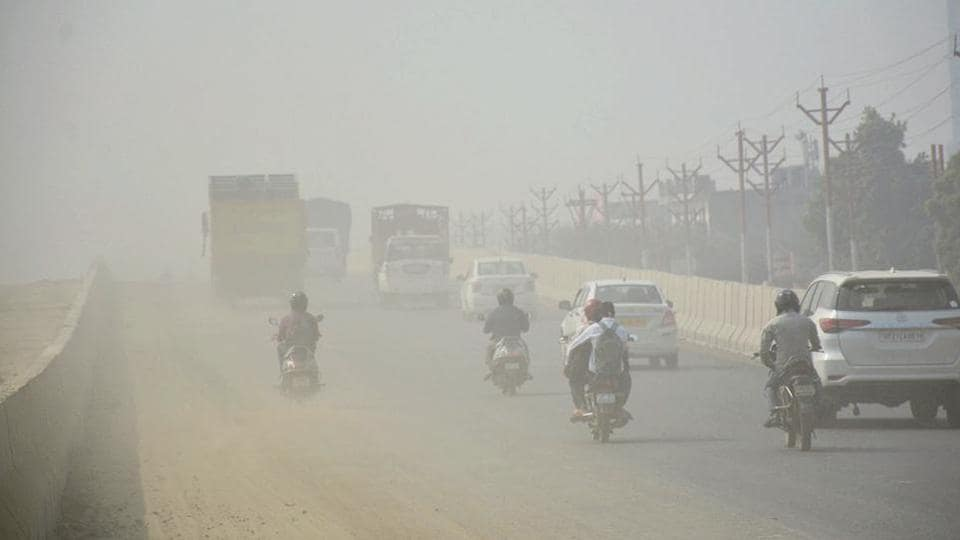 Commuters make their way through dust-engulfed NH9  in Ghaziabad, Thursday, October 24, 2019.