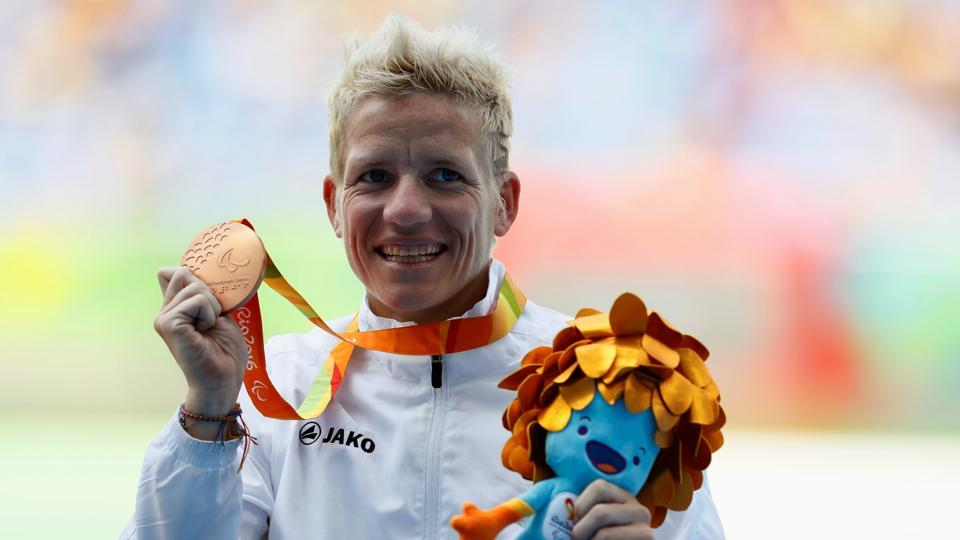 FILE PHOTO: Marieke Vervoort of Belgium celebrates with her bronze medal during the victory ceremony.