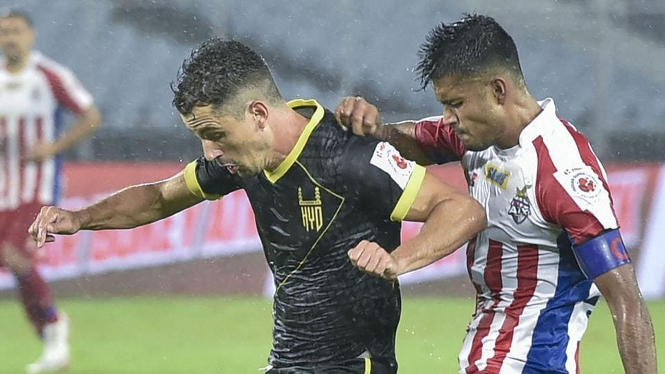 Kolkata: ATK Captain Pritam Kotal and Hyderabad FC player Marcelo Leite Pereira in action.