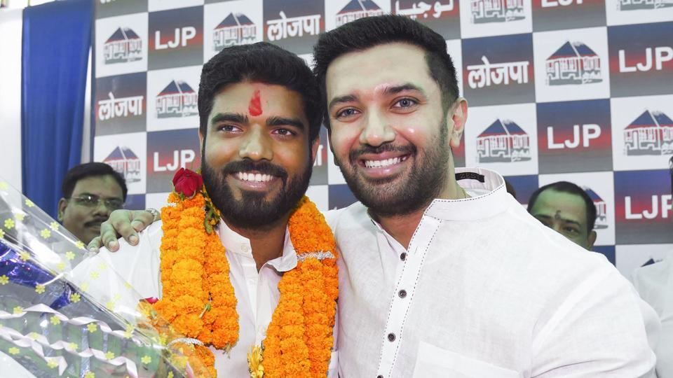 Lok Janshakti Party (LJP) parliamentary board chairman Chirag Paswan poses with the party's newly elected MP from Samastipur, Prince Raj, during a press conference in Patna.
