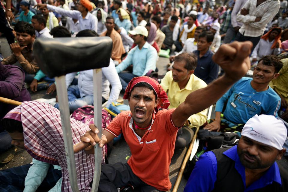 Differently-abled railway applicants raise slogans during a protest against Railway Ministry, at Mandi House circle, in New Delhi,  on Thursday, October 24, 2019.