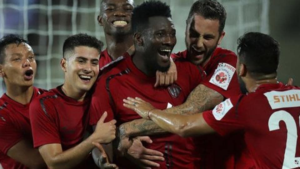 Asamoah Gyan celebrates after scoring for NorthEast United.