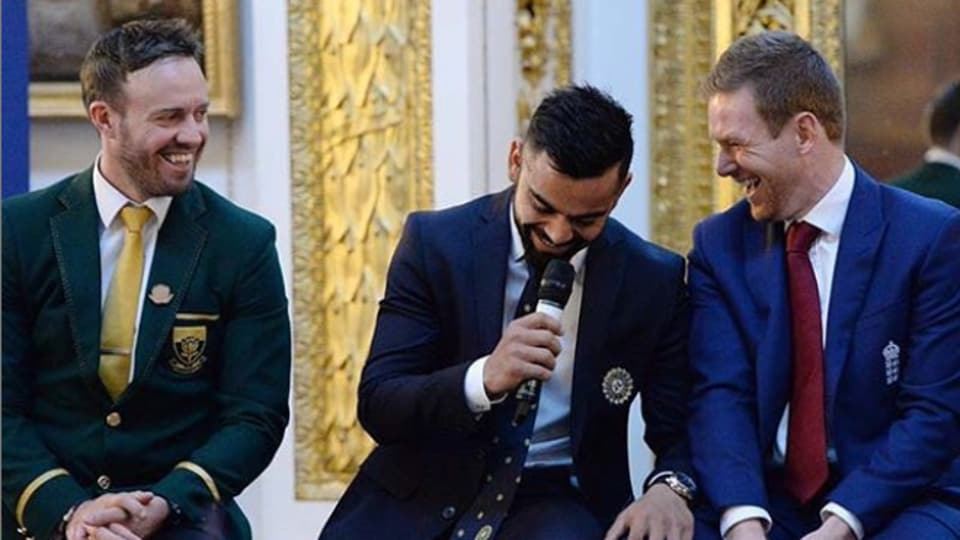 Virat Kohli with AB de Villiers and Eoin Morgan.