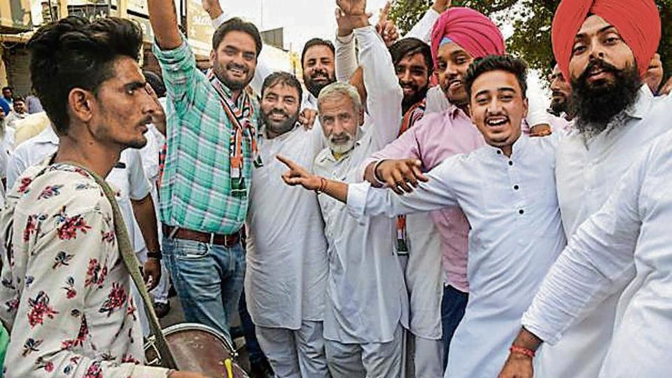 Congress supporters celebrate the results in Karnal on Thursday.