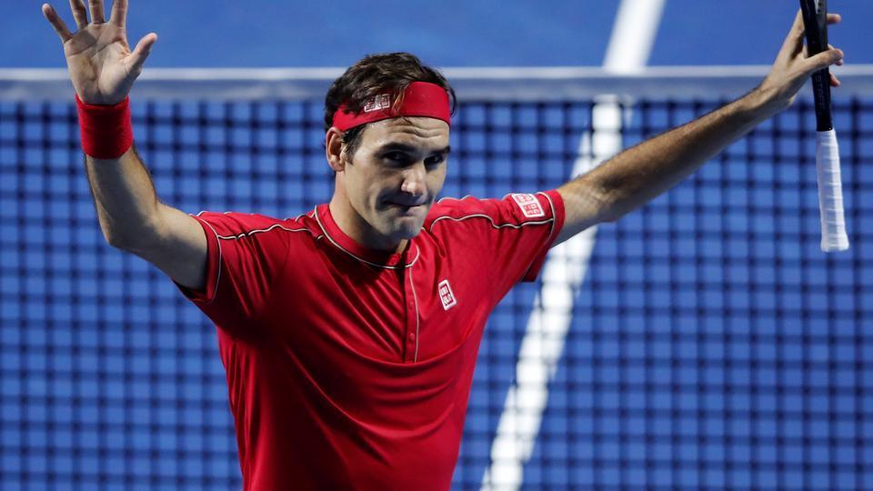 Switzerland's Roger Federer celebrates after winning his semi final match against Greece's Stefanos Tsitsipas.