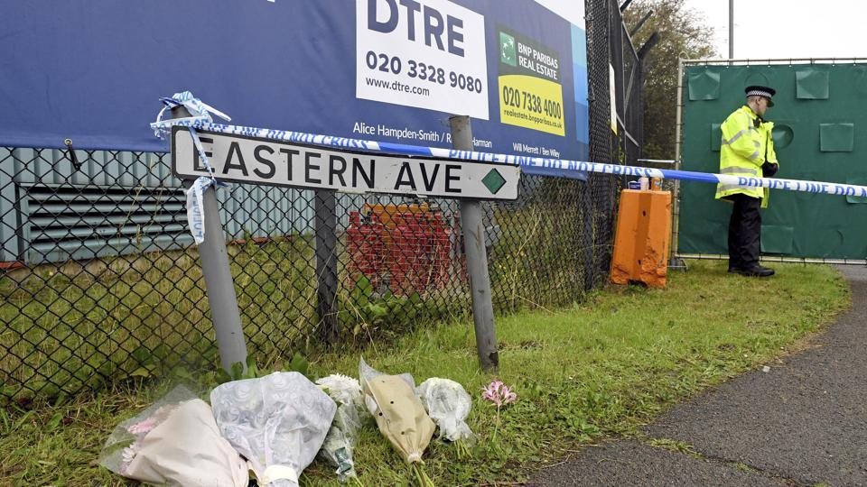 British Police has charged Maurice Robinson for human trafficking, manslaughter and money laundering. In this file picture, floral tributes at the Waterglade Industrial Park in Thurrock, Essex, the day after 39 bodies were found inside a truck on the industrial estate. British media are reporting that the 39 people found dead in the back of a truck in southeastern England were Chinese citizens.