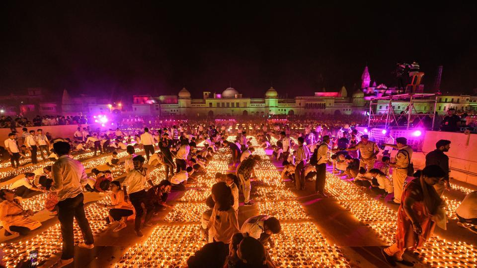 Devotees light earthen lamps on the bank of Saryu River during Deepotsav celebrations in Ayodhya, which created a record for the most number of lamps lit in the Guinness Book of World Records.