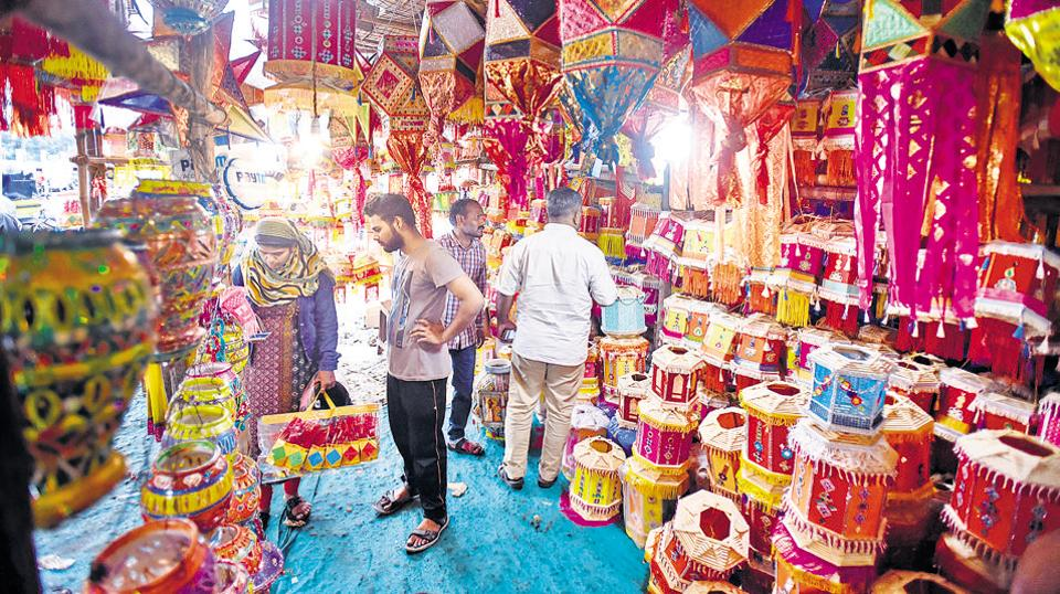 People buy lanterns at shop in riverbed area near Bhide bridge on Friday. The untimely rains have dampened the sales of Diwali merchandise.