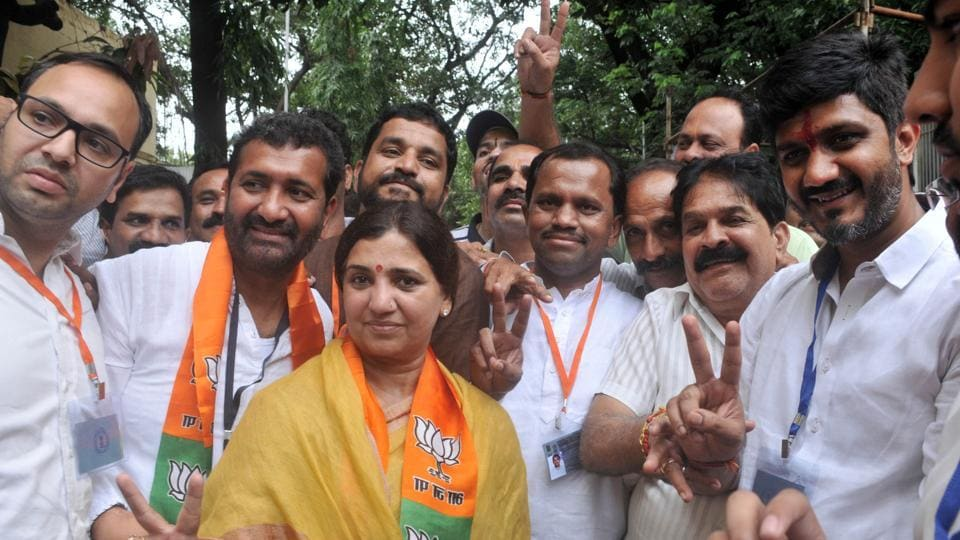BJP's Madhuri Misal (centre) retained the Parvati assembly constituency on Thursday.