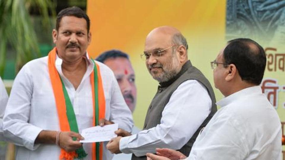Home Minister Amit Shah gives party membership slip to senior NCP leader Udayanraje Bhosale, after the latter joined BJP  on September 14.  Udayanraje lost in Satara (Lok Sabha bypoll)