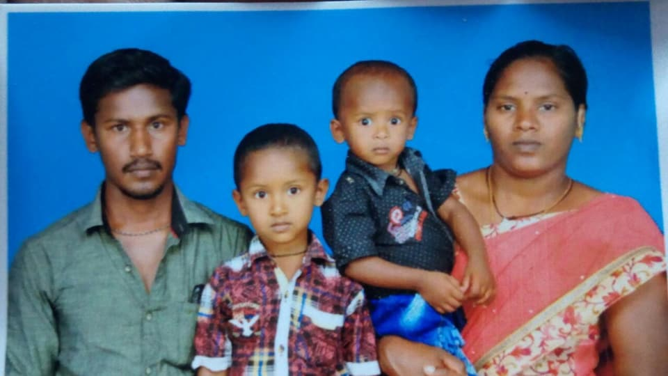 Two-year-old Surjith Wilson seen in his mother's arms was playing when he fell into the abandoned borewell.