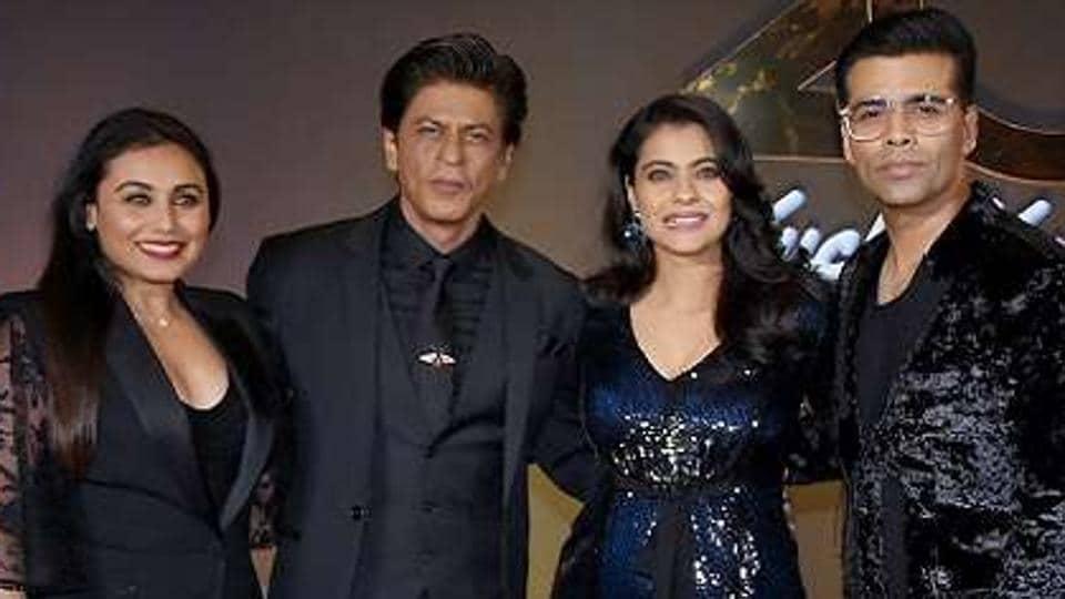 Karan Johar celebrates the 20th anniversary of Kuch Kuch Hota Hai in 2018, with cast members Shah Rukh Khan, Kajol and Rani Mukerji.