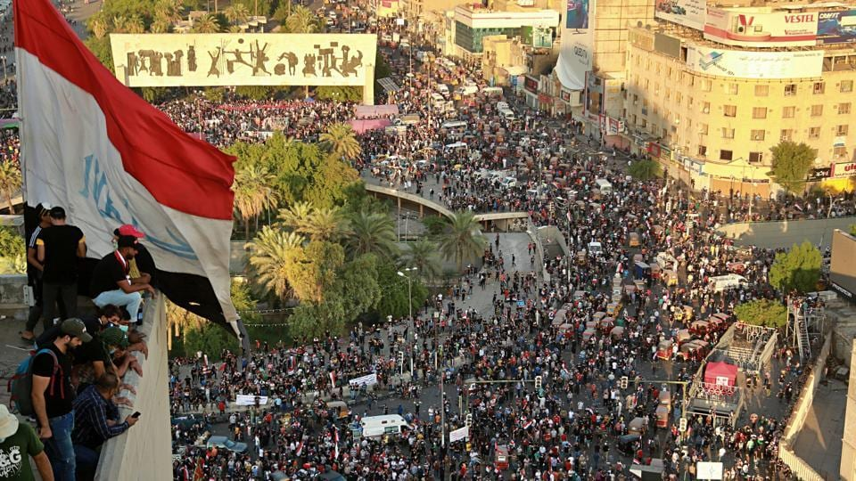 Anti-government protesters gather in Tahrir square during a demonstration in Baghdad.