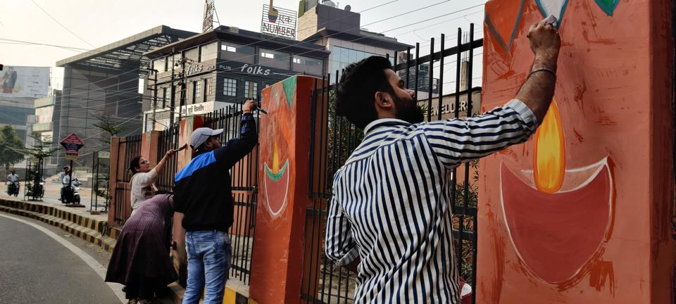 Volunteers beautifying Agra on Sunday morning. Diwali was celebrated on the day.