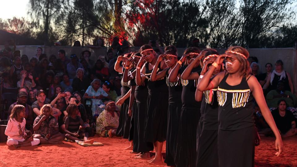 "Indigenous Anangu perform a traditional dance during a ceremony marking the permanent ban. ""I think it is important that mother nature has a bit of a break,"" the last climber at Uluru, James Martin, said. ""I would like to say to the Aboriginals that we are sorry and the world does indeed belong to every single person who was born on the planet,"" the Australian told reporters as he came off the rock. (Saeed Khan / AFP)"