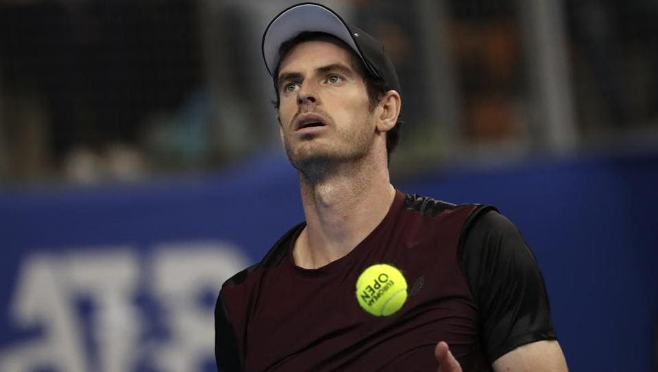 Andy Murray of Britain gets ready to serve to Stan Wawrinka of Switzerland.