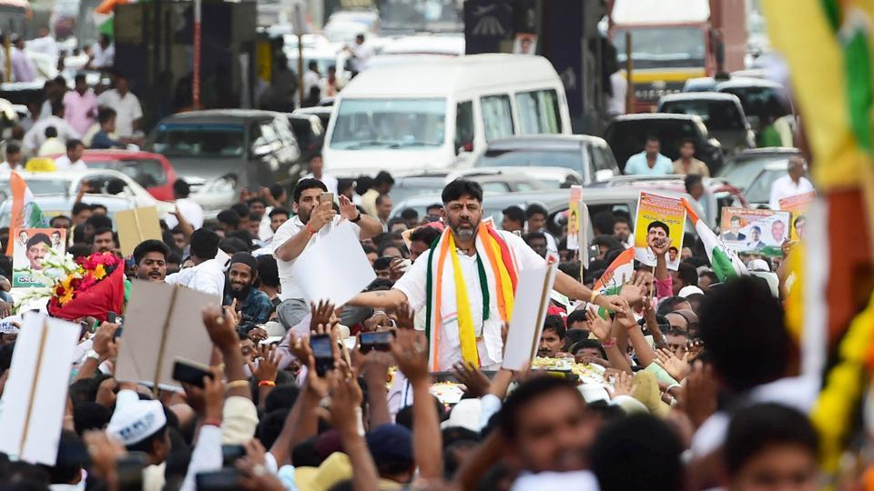 Congress leader D K Shivakumar being welcomed by his supporters on his arrival in Bengaluru.