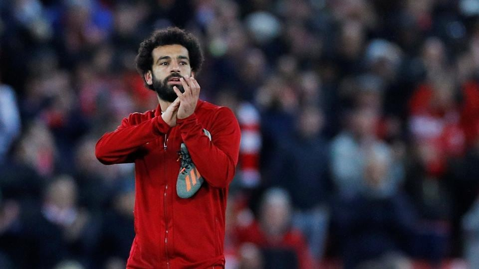 Mohamed Salah applauds the fans after the match