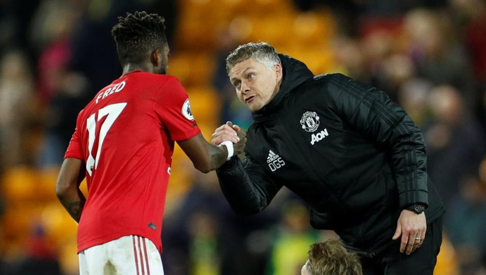 Manchester United manager Ole Gunnar Solskjaer shakes hands with Fred after the match.