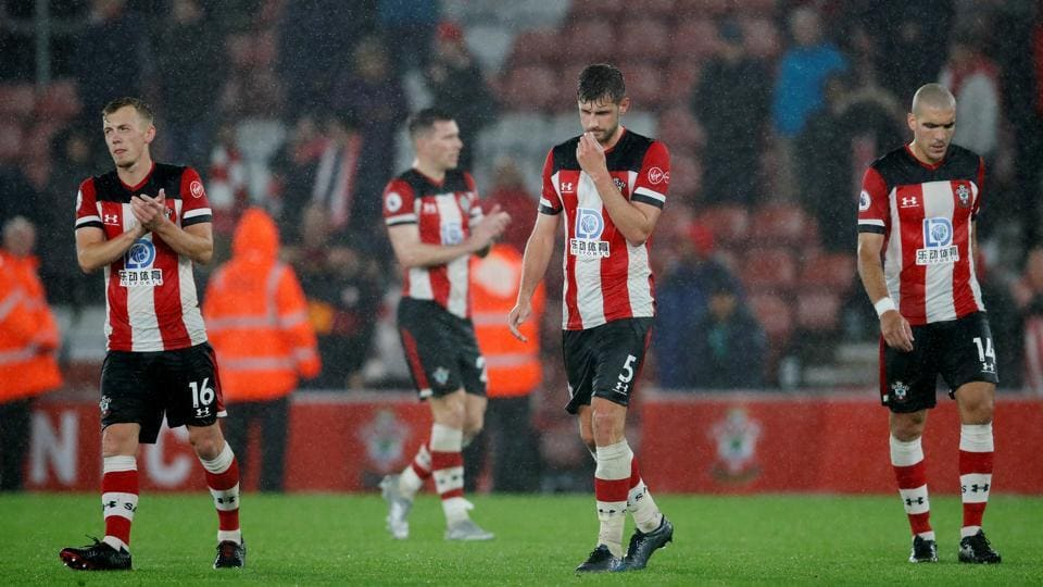 Southampton's Jack Stephens, James Ward-Prowse and Oriol Romeu look dejected at the end of the match.