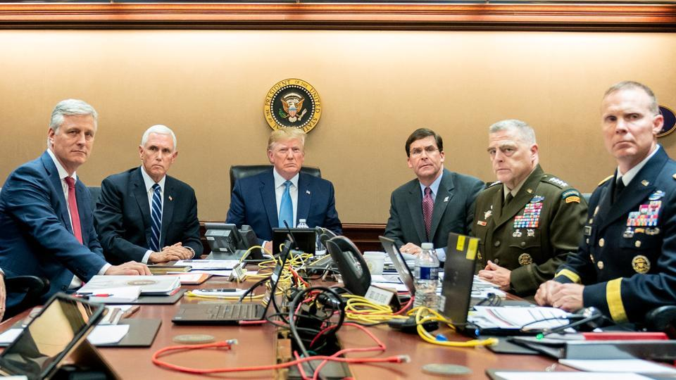 US President Donald Trump, U.S. Vice President Mike Pence (2nd L), USSecretary of Defense Mark Esper (3rd R), along with members of the national security team, watch as US Special Operations forces close in on ISIS leader Abu Bakr al-Baghdadi, in the Situation Room of the White House in Washington.