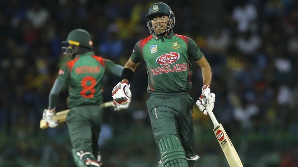 Bangladeshi batsmen Soumya Sarkar, right, and Mohammad Mithun run between wickets.