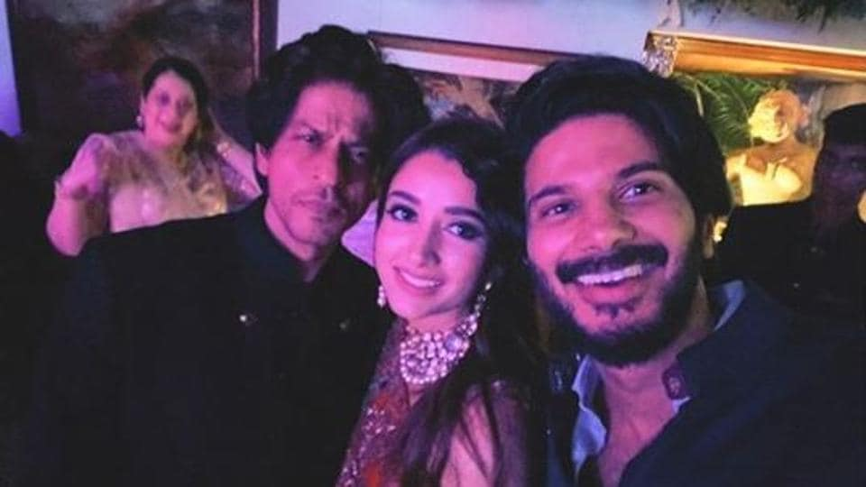 Shah Rukh Khan posed with Dulquer Salmaan and his wife Amaal Nizam Salmaan at the Bachchan Diwali party.