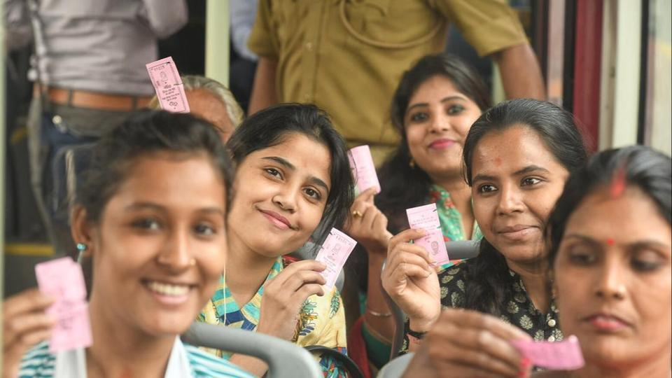 Women passengers show their free DTC tickets while travelling in east Delhi's Laxmi Nagar.