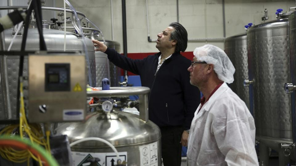 "Bruce Khabbazi (C) at his distillery in Peterborough, Canada. ""I was looking for something extraordinarily unique and I found the slang of a traditional popular Arak,"" said Khabbazi, a 50-year-old Iranian-Canadian entrepreneur who established the Persian Empire Distillery in 2006. ""I felt the need to give this drink an identity as well as originality. My task became Introducing Arak Saggi to the world as a classic alcoholic drink of Iranians."" (Kamran Jebreili / AP)"