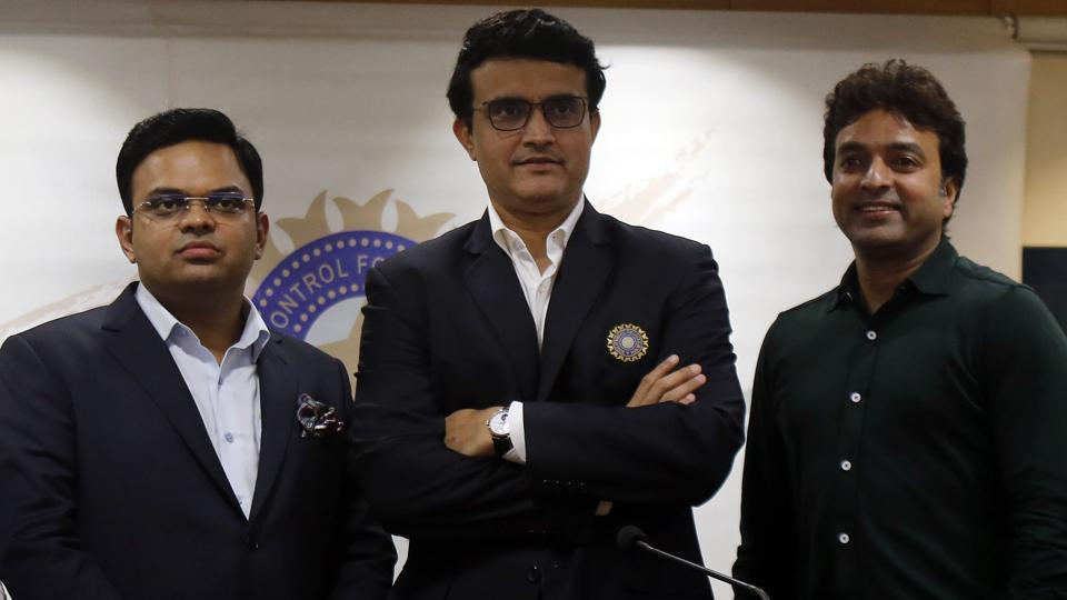 Sourav Ganguly, center, Secretary Jay Shah, left, and Treasurer Arun Dhumal stand for a photograph.