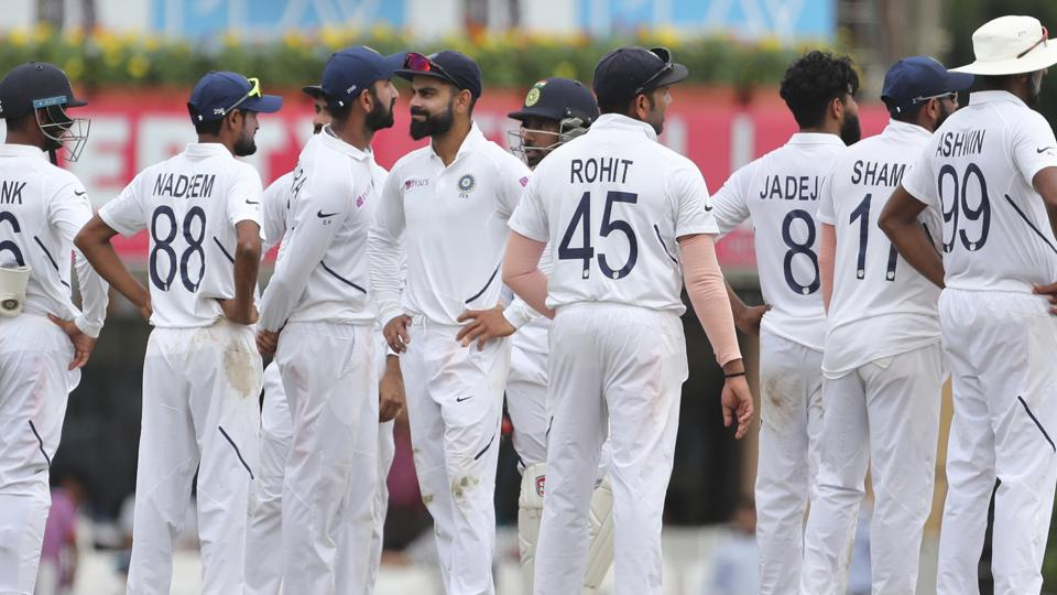 India's captain Virat Kohli, fifth left, reacts after losing a review.