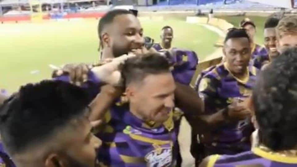 Trinbago Knight Riders coach Brendon McCullum with teammates during birthday celebrations.