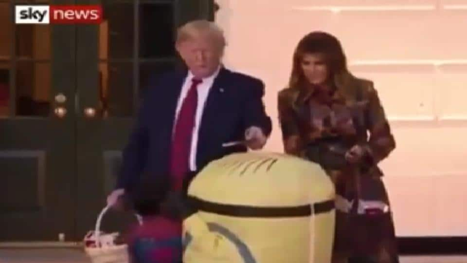 The now viral clip shows Donald Trump placing a candy bar on top of the child's head.