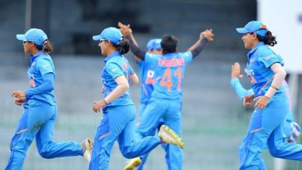 Players of Indian women's team celebrate after picking up a wicket.